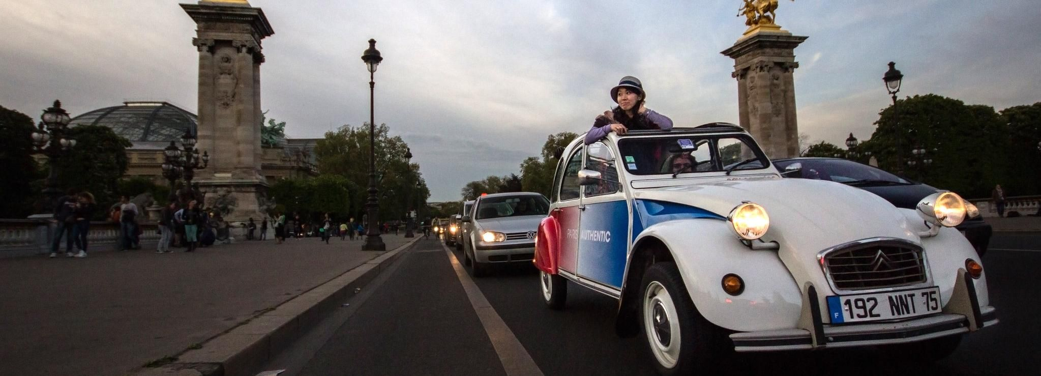 Discover Paris by Night in a Vintage Car with a Local