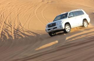 Dubai: Quad-Fahrt durch die Wüste mit Sandboarding