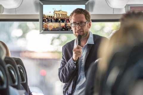 Berlin: Video Time Travel Bus Tour in German