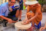 Bat Trang Pottery ancient village by Motorbike