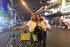 Xangai: Excursão de bicicleta de aventura e degustação de vida noturna de 4 horas