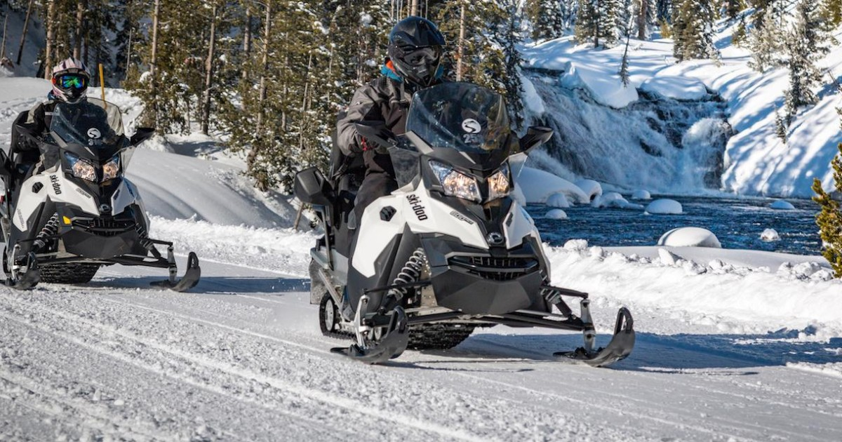 From Jackson Yellowstone Snowmobile Tour To Old Faithful Jackson Wyoming United States Getyourguide