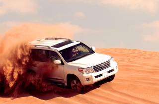 Ab Dubai: Wüstensafari mit Quad, Sandboarding & Kamelritt