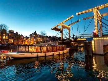 Amsterdam: Abendliche Luxus-Grachtenfahrt mit Guide