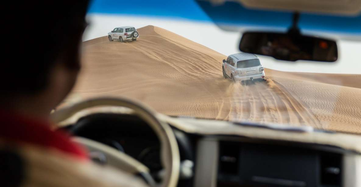 Abu Dhabi: Desert Safari with BBQ, Camel Ride & Sandboarding