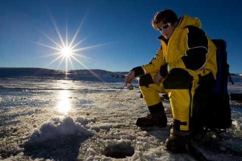 Rovaniemi: Snowmobile Safari with Ice Fishing and Picnic
