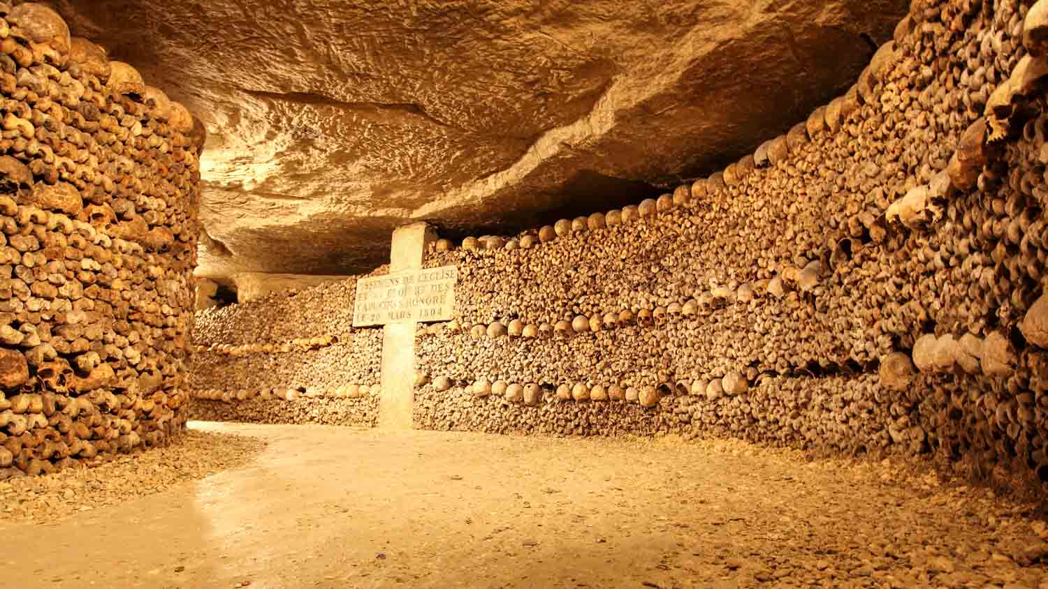 the catacombs of paris Discover catacombes de paris in paris, france: the catacombs hold secrets much stranger than the bones stacked within them.